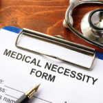 Medical Necessity form on a table.